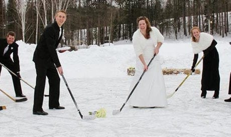 wedding party with hockey sticks